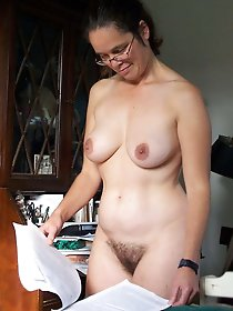 Attractive mature cutie getting undressed on cam